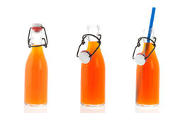 Row Bracket bottles with beverage Stock Images