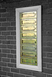 Row of brass letterboxes Stock Photography