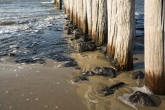Breakwaters in the North Sea, Cadzand Bad, Holland. Row breakwaters on the North Sea beach, Cadzand Bad, The Netherlands. waves, sand and sunshine stock photo