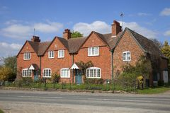 Row of brick cottages, Gloucestershire Stock Photos