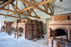 Dachau, Upper Bavaria / Germany - March 2018: Crematorium inside the Dachau Concentration Camp. A row of brick ovens inside camp`s crematorium, at Dachau royalty free stock photography