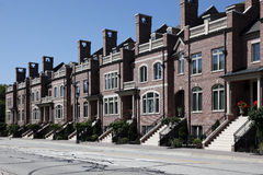 Row of brick townhomes Stock Photo