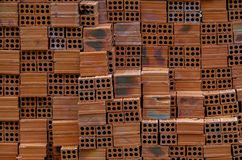 The row of bricks used in construction works stock images