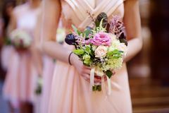 Row of bridesmaids with bouquets at wedding stock photography