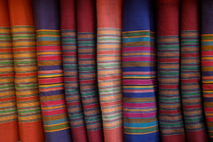 Row of bright colorful traditional strip pattern fabric textile Stock Image