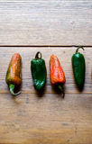Row of bright green and red hot peppers Stock Photography