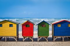 Row of brightly colored huts in Muizenberg beach. Muizenberg Royalty Free Stock Photography