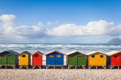 Row of brightly colored huts in Muizenberg beach. Muizenberg. Cape Town. South Africa Stock Images