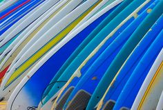 Row of Brightly Colored Surf Boards Stock Photo