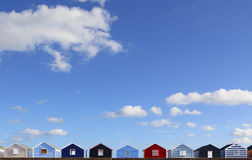 Row of brightly coloured beach huts. On a seaside promenade in England Royalty Free Stock Photography