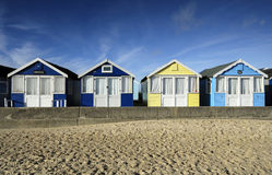 Row of brightly coloured beach huts. At Hengistbury Head near Christchurch in Dorset Stock Photography