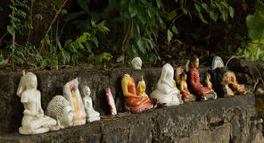 Row of Broken Buddha Statues Royalty Free Stock Images