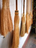 Row of brooms Royalty Free Stock Photos