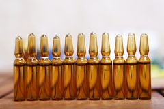 Row of brown vials filled Stock Images