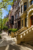 Row of brownstones on the Upper West Side. Manhattan, New York City. Row of brownstones with doorsteps and ornament in morning light. Upper West Side Street Stock Photo