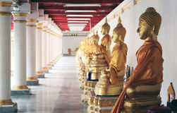 Row of buddha statue in a Buddhist temple. Golden Buddha statue in Thailand Royalty Free Stock Photography
