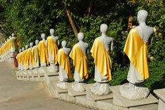 Row of Buddha Statues. At the Mengle Dafusi (Dafo) monastery at Jinghong, Xishuangbanna, province Yunnan, China Stock Photo