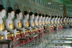Row of Buddha statues,. Temple interior with many buddha statues, Sagaing, Hill, Near, Mandalay, Myanmar, Asia Royalty Free Stock Photos