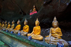 A row of Buddha statues in the cave. Buddha statues in the cave, Petchburi province of Thailand Royalty Free Stock Image