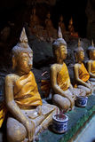 A row of Buddha statues in the cave. Buddha statues in the cave, Petchburi province of Thailand Royalty Free Stock Photo