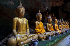 A row of Buddha statues in the cave. Buddha statues in the cave, Petchburi province of Thailand Royalty Free Stock Photography