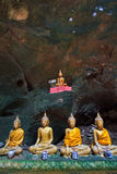 A row of Buddha statues in the cave Stock Photography