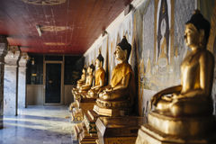 Row of Buddha statues. Stock Photos