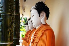 Row of Buddha statues. Stock Photo