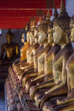 Row of Buddha Statues in Thailand Royalty Free Stock Photography