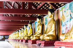 Row of Buddha statues in Wat Phra Borommathat Chaiya province Su Stock Photos