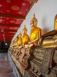 Row of buddha statues in Wat Po temple Stock Photos