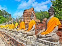 A row of buddha statues at Wat Yai Chai Mongkhon in Thailand Stock Photo