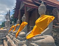 Row of Buddha Status backside church the at Yai Chaimongkol temple. Was built in century 1357 royalty free stock photography
