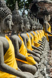Row of Buddha Status at Wat Yai Chaimongkol. Ayutthaya, Thailand Stock Images