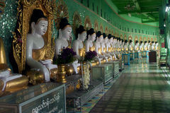 Row of Buddhas in U Min Thonze cave ,Sagaing hill,Myanmar. Stock Images