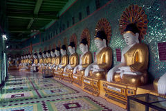 Row of Buddhas in U Min Thonze cave ,Sagaing hill,Myanmar. Stock Photos