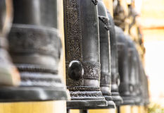 Row of buddhist Bells - Shallow Depth of Field. Perspective of a row of buddhist bells in Doi Suthep temple near Chiang Mai Royalty Free Stock Images