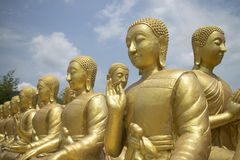 Row of Buddhist disciple statues. Row of disciple statues of the Buddhist stock photography