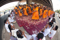 Row of Buddhist hike monks on street. Royalty Free Stock Photo