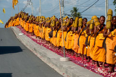 Row of Buddhist hike monks on street. Stock Images