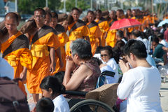 Row of Buddhist hike monks on street. Stock Photo
