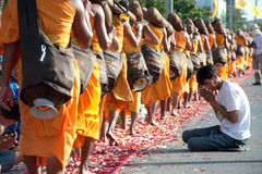 Row of Buddhist hike monks on street. Royalty Free Stock Photos