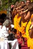Row of Buddhist hike monks on street. Stock Photos
