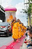 Row of Buddhist hike monks on streets Royalty Free Stock Images