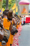 Row of Buddhist hike monks on streets Royalty Free Stock Photography