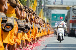 Row of Buddhist hike monks on streets Royalty Free Stock Photos