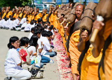 Row of Buddhist hike monks on streets Stock Photos