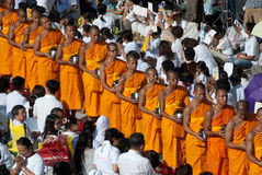 Row of Buddhist monks for peoples give food offerings. Royalty Free Stock Photos
