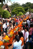 Row of Buddhist Monks on Phrabuddhabat Woramahavihan temple. Stock Photos