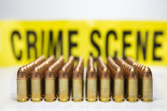 Row of bullet with crime scene tape background Royalty Free Stock Photos
